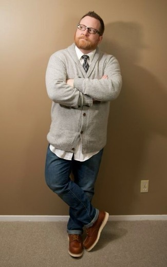 How to wear: grey shawl cardigan, white long sleeve shirt, navy jeans, brown leather work boots
