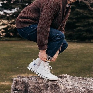 Navy Jeans Outfits For Men: Demonstrate your prowess in menswear styling by teaming a brown shawl cardigan and navy jeans for a relaxed look. You can get a bit experimental on the shoe front and complement this outfit with white canvas high top sneakers.
