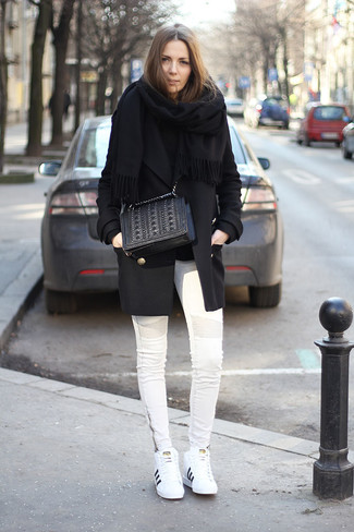 Get into glamour mode in a black coat and an Armani Collezioni women's Faux Fur Wrap Shawl. Grab a pair of white leather low top sneakers to make the ensemble current. As you can imagine, this is also a kick-ass pick come warmer weather.