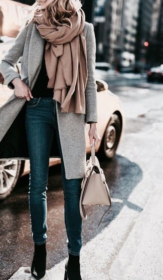 How to wear: tan shawl, grey coat, black crew-neck sweater, navy skinny jeans