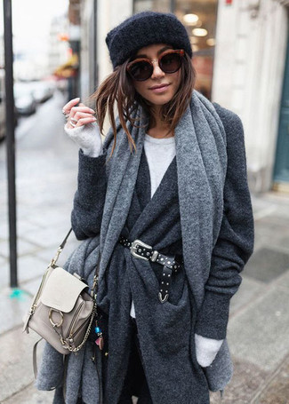 Rock a dark grey coat with black skinny jeans for a standout ensemble. A perfect example of transitional fashion, this look is great come warmer days.