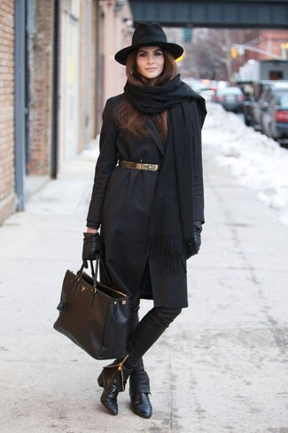 Pair a black coat with black leather slim pants to achieve a neat and proper look. This outfit is complemented perfectly with black leather ankle boots.