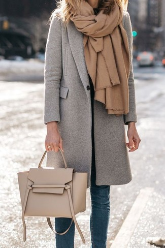 How to wear: tan shawl, grey coat, black turtleneck, blue skinny jeans
