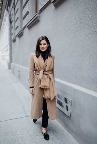 How to wear: tan shawl, camel coat, black turtleneck, black ripped skinny jeans