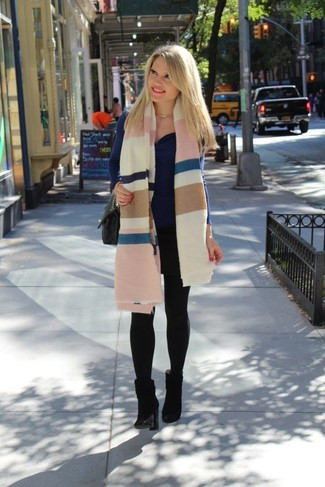 How to wear: multi colored horizontal striped shawl, navy cowl-neck sweater, black suede ankle boots, black quilted leather satchel bag