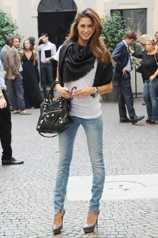 Wear a white crew-neck tee and a shawl for an unexpectedly cool ensemble. Why not introduce grey leather pumps to the mix for an added touch of style? This combo is super functional and will help you out in unpredictable spring weather.