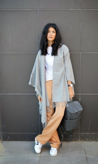 Grey Leather Backpack Outfits For Women: You'll be surprised at how very easy it is to put together this casual look. Just a white crew-neck t-shirt and a grey leather backpack. To bring a playful feel to this outfit, add white athletic shoes to the mix.