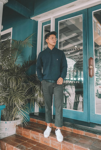 How to wear: black shawl-neck sweater, black crew-neck t-shirt, charcoal chinos, white canvas low top sneakers