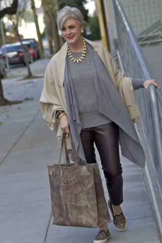 How to wear: beige shawl, grey open cardigan, grey crew-neck sweater, dark brown leather skinny pants