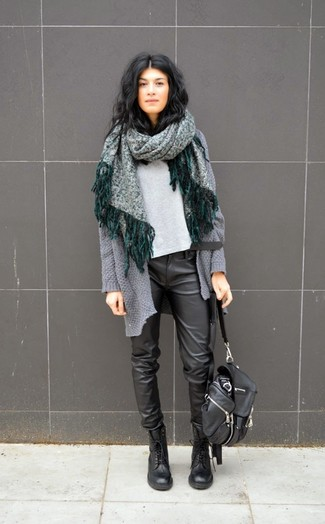 If you're a jeans-and-a-tee kind of gal, you'll like the simple combo of a grey knit open cardigan and black leather drawstring pants. Finish off with black leather lace-up flat boots and off you go looking stunning. There's nothing like a kick-ass ensemble to cheer up a dreary autumn day.