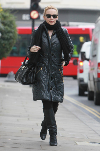 How to wear: black shawl, black puffer coat, black leggings, black leather knee high boots