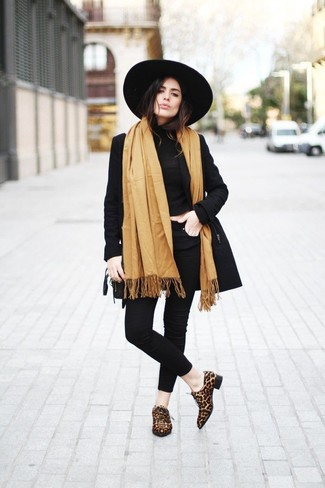 How to wear: tan shawl, black trenchcoat, black turtleneck, black skinny jeans