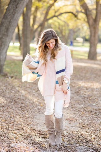 How to wear: multi colored horizontal striped shawl, pink knit turtleneck, white skinny jeans, beige suede knee high boots