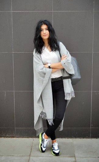 Grey Leather Backpack Outfits For Women: This casual combo of a white v-neck t-shirt and a grey leather backpack is a surefire option when you need to look chic in a flash. Complement this ensemble with a pair of grey athletic shoes to inject a hint of casualness into this look.
