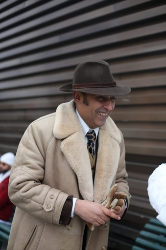 How to wear: beige shearling coat, dark brown blazer, olive wool waistcoat, white dress shirt