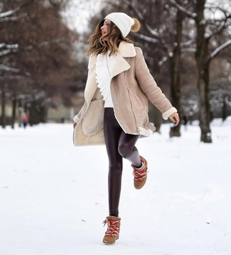 How to wear: beige shearling coat, white ruffle crew-neck sweater, black leather leggings, brown leather wedge ankle boots