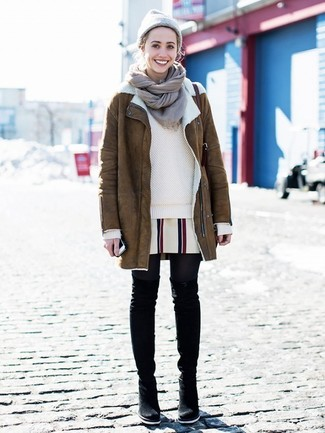 How to wear: brown shearling coat, beige crew-neck sweater, white vertical striped shift dress, black suede over the knee boots