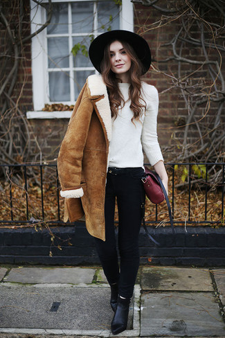 How to Wear a Black Wool Hat For Women: Such pieces as a tan shearling coat and a black wool hat are an easy way to infuse extra cool into your current casual wardrobe. Introduce black leather ankle boots to the mix for an extra touch of chic.