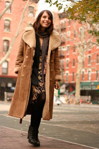 How to wear: brown shearling coat, black open cardigan, black floral sheath dress, black leather lace-up ankle boots