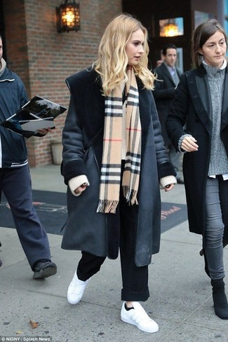 How to wear: black shearling coat, beige knit oversized sweater, black wide leg pants, white leather low top sneakers