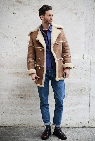 Men's Looks & Outfits: What To Wear In Winter Smart Casually: Pair a brown shearling coat with blue jeans to feel unstoppable and look casually dapper. For something more on the classier end to complement this ensemble, complement your getup with burgundy leather oxford shoes. In the colder months, when functionality is crucial, it can be easy to settle for a less-than-stylish look in the name of practicality. This look, however, is a clear example that you can actually stay comfy and remain stylish at the same time in the colder months.