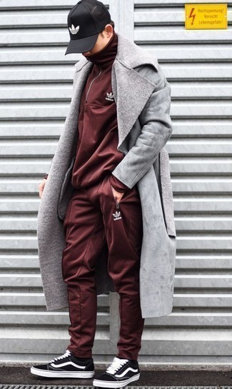 Track Suit Outfits For Men: If you're on the lookout for a modern casual and at the same time seriously stylish outfit, make a track suit and a grey shearling coat your outfit choice. Black and white canvas low top sneakers are a nice choice to finish this look.