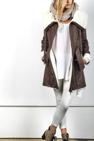 How to wear: dark brown shearling coat, white tunic, white leather skinny pants, brown suede lace-up ankle boots