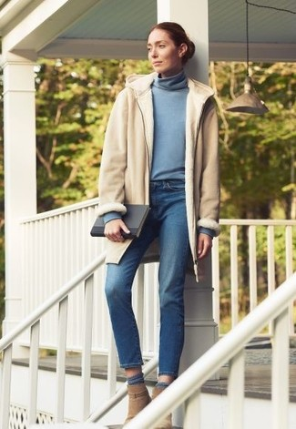 How to wear: beige shearling coat, light blue turtleneck, blue jeans, tan suede ankle boots