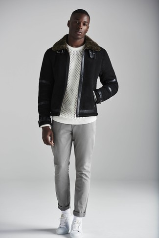 How to wear: black shearling jacket, white cable sweater, grey chinos, white leather low top sneakers