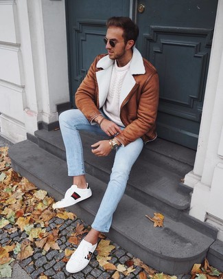How to wear: tobacco shearling jacket, white cable sweater, light blue jeans, white print leather low top sneakers