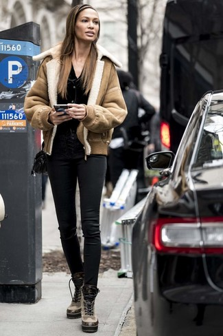 How to wear: tan shearling jacket, black cardigan, black leather skinny pants, tan leather lace-up flat boots