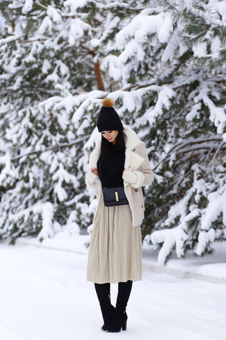 Opt for a beige shearling jacket and a cream pleated midi skirt and you'll look like a total babe. For the maximum chicness rock a pair of black suede knee high boots.