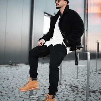 Work Boots Outfits For Men: This pairing of a black shearling jacket and black cargo pants is proof that a simple casual outfit can still be really interesting. For a more casual twist, complement this outfit with work boots.
