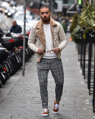 How to wear: beige shearling jacket, white crew-neck sweater, grey plaid chinos, tobacco suede low top sneakers