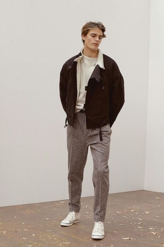 Men's Looks & Outfits: What To Wear In Cold Weather: A dark brown shearling jacket and brown vertical striped chinos are the perfect way to infuse effortless cool into your casual styling rotation. Complete this ensemble with a pair of white canvas low top sneakers to mix things up.