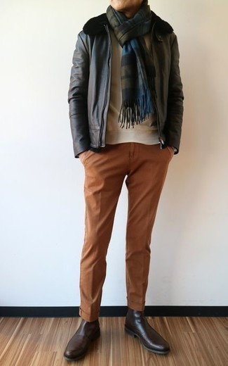 How to Wear a Black Shearling Jacket For Men: For a look that's super simple but can be manipulated in a myriad of different ways, rock a black shearling jacket with tobacco chinos. You can take a classic approach with footwear and complete this outfit with a pair of dark brown leather chelsea boots.