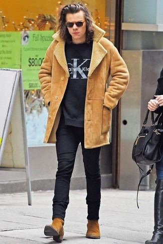 Harry Styles wearing Tan Shearling Jacket, Black Print Crew-neck Sweater, Black Wool Dress Pants, Tan Suede Chelsea Boots