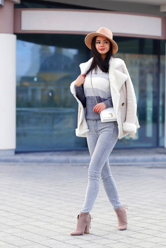 Consider wearing a beige shearling jacket and grey jeans for a comfortable outfit that's also put together nicely. Elevate your getup with cream suede booties.