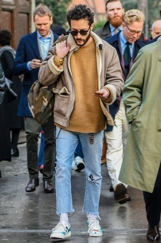 How to Wear a Gold Watch For Men: This combination of a beige shearling jacket and a gold watch is on the off-duty side but guarantees that you look sharp and really stylish. For extra style points, add a pair of white print leather low top sneakers to the equation.