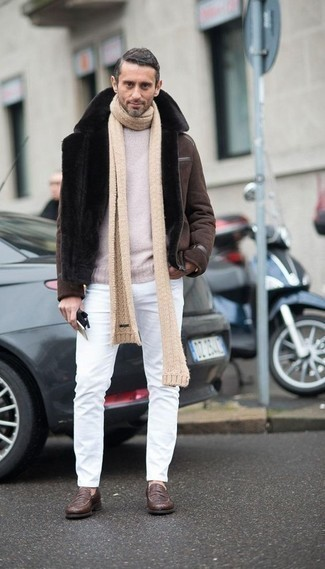 How to Wear a Brown Shearling Jacket For Men: A brown shearling jacket and white jeans are an easy way to inject effortless cool into your current fashion mix. A pair of brown leather loafers effortlessly kicks up the wow factor of any outfit.