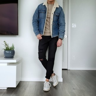 Beige Crew-neck Sweater Outfits For Men: Go for a beige crew-neck sweater and black ripped jeans for both stylish and easy-to-wear getup. Feeling adventerous? Switch up this outfit by wearing a pair of white leather low top sneakers.