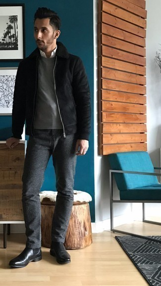 500+ Winter Outfits For Men: We give a huge thumbs up to this casual combination of a black shearling jacket and charcoal chinos! For a more sophisticated twist, complement your look with a pair of black leather chelsea boots. During the colder months, when warmth is everything, it can be easy to surrender to a less-than-stylish ensemble in the name of convenience. But this ensemble is a shining example that you can actually stay toasty and remain stylish in the colder months.