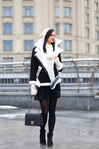 How to wear: black and white shearling jacket, white crew-neck sweater, black skater skirt, black suede lace-up flat boots