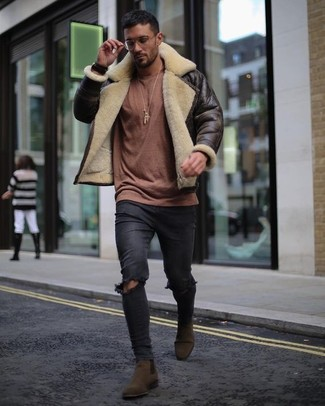 How to wear: dark brown shearling jacket, brown crew-neck sweater, black ripped skinny jeans, dark brown suede chelsea boots