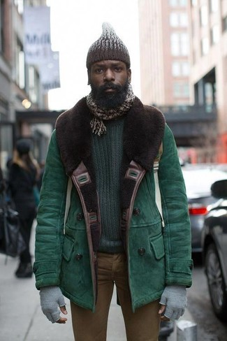 How to wear: green shearling jacket, dark green crew-neck sweater, brown skinny jeans, dark brown knit beanie