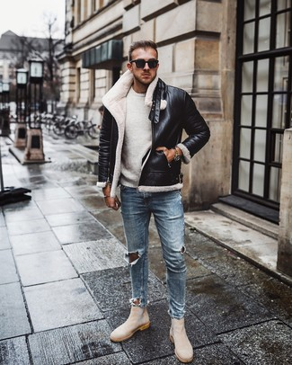 How to Wear Beige Suede Chelsea Boots For Men: Breathe personality into your daily repertoire with a black and white shearling jacket and light blue ripped skinny jeans. Rounding off with beige suede chelsea boots is a fail-safe way to give an added dose of class to this ensemble.
