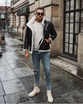 500+ Winter Outfits For Men: Consider teaming a black shearling jacket with light blue ripped skinny jeans if you're hunting for a look idea for when you want to look casually stylish. Finish off with a pair of beige suede chelsea boots to upgrade your outfit. In the winter season, when practicality is crucial, it can be easy to surrender to a less-than-stylish ensemble. But this ensemble is a stark illustration that you can actually stay warm and remain equally stylish during the winter season.