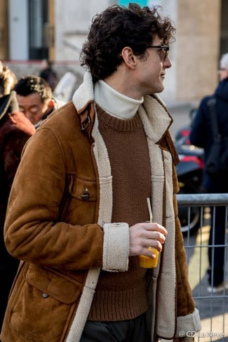 How to wear: brown shearling jacket, brown knit crew-neck sweater, white turtleneck, black dress pants
