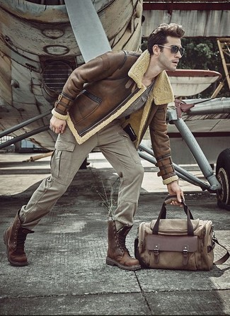 How to wear: brown shearling jacket, grey crew-neck t-shirt, grey cargo pants, brown leather casual boots