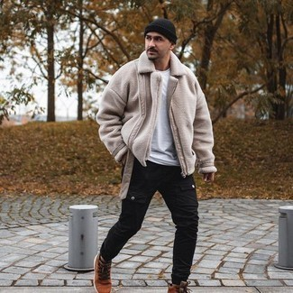 Black Beanie Outfits For Men: One of the best ways for a man to style a beige shearling jacket is to combine it with a black beanie in a relaxed casual combo. Go off the beaten track and change up your getup by finishing off with a pair of tobacco suede casual boots.